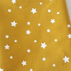 Tissu coton étoile jaune moutarde